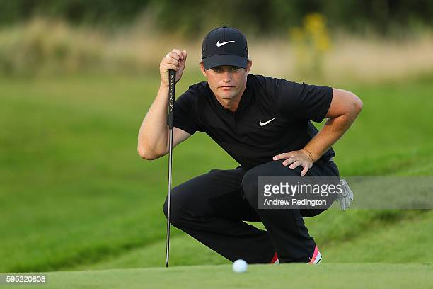 Tom Lewis of England lines up a putt on the 6th green during the first round of Made in Denmark at Himmerland Golf Spa Resort on August 25 2016 in...