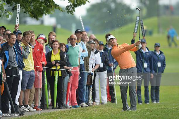 Tom Lewis of England plays his approach shot to the third green during the final round of the Lyoness Open at Diamond Country Club on June 12 2016 in...