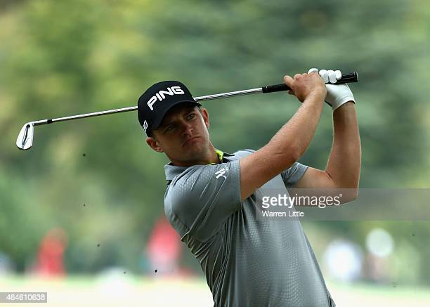 Tom Lewis of England plays his second shot into the first green during the second round of the Joburg Open at Royal Johannesburg and Kensington Golf...