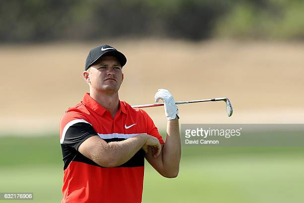 Tom Lewis of England plays his second shot on the 17th hole during the second round of the 2017 Abu Dhabi HSBC Golf Championship at Abu Dhabi Golf...