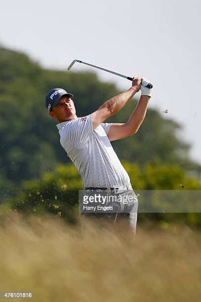 Tom Lewis of England plays his second shot out of the rough on the ninth hole on day three of the Nordea Masters at the PGA Sweden National on June 6...