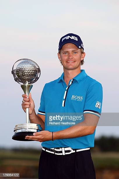 Tom Lewis of England poses with the trophy after securing victory in the final round the Portugal Masters at Oceanico Victoria Golf Course on October...