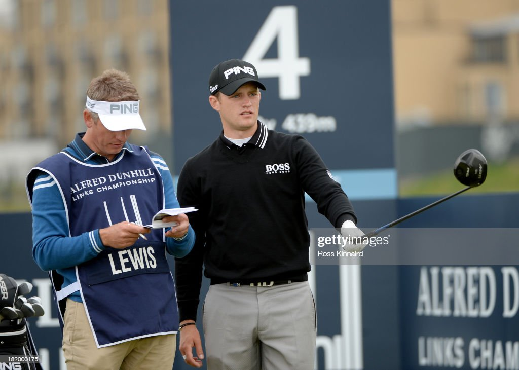 Tom Lewis of England with his caddy on the fourth tee during the second round of the Alfred Dunhill Links Championship on The Old Course, at St Andrews on September 27, 2013 in St Andrews, Scotland.