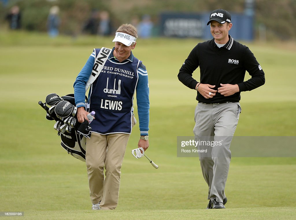 Tom Lewis of England with his caddy walking off third green during the second round of the Alfred Dunhill Links Championship on The Old Course, at St Andrews on September 27, 2013 in St Andrews, Scotland.