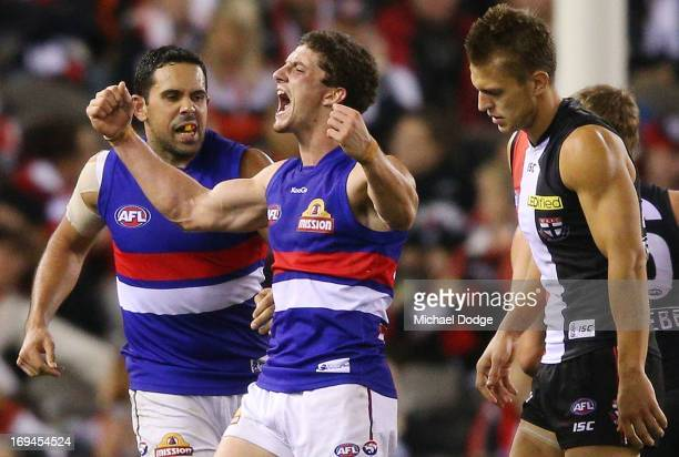 Tom Liberatore and Brett Goodes of the Bulldogs celebrate their win during the round nine AFL match between the St Kilda Saints and the Western...