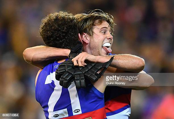 Tom Liberatore and Caleb Daniel of the Bulldogs celebrate winning the second AFL semi final between Hawthorn Hawks and Western Bulldogs at Melbourne...