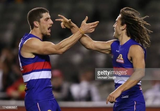 Tom Liberatore and Luke Dahlhaus of the Bulldogs celebrate a goal during the round 18 AFL match between the Western Bulldogs and the West Coast...