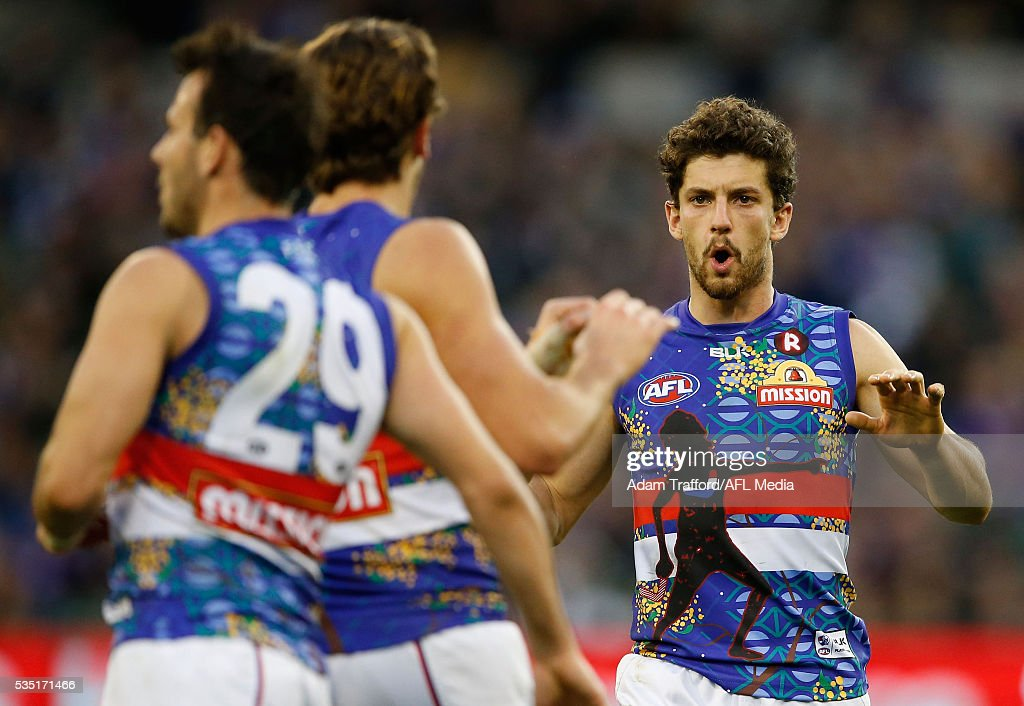 Tom Liberatore of the Bulldogs celebrates during the 2016 AFL Round 10 match between the Collingwood Magpies and the Western Bulldogs at the Melbourne Cricket Ground on May 29, 2016 in Melbourne, Australia.