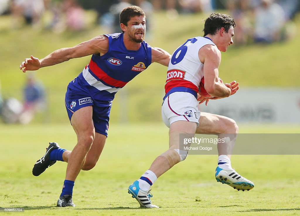 Tom Liberatore of the Bulldogs, coming back from a knee reconstruction, tackles Toby McLean of the Bulldogs during the Western Bulldogs AFL intra-club match at Whitten Oval on February 13, 2016 in Melbourne, Australia.