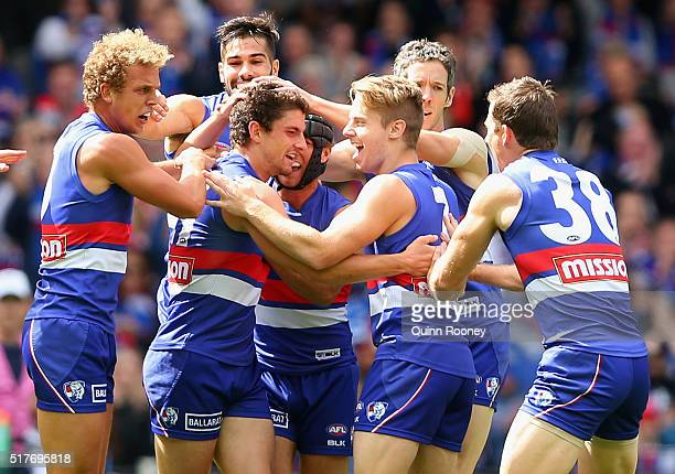 Tom Liberatore of the Bulldogs is congratulated by team mates after kicking a goal during the round one AFL match between the Western Bulldogs and...