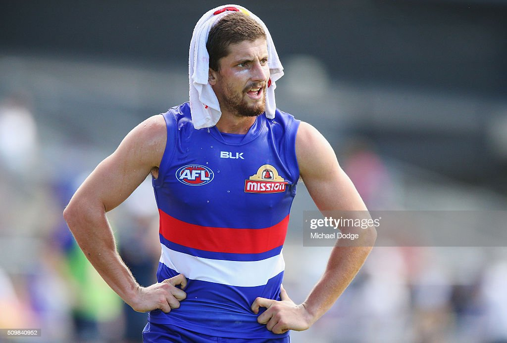 Tom Liberatore of the Bulldogs, making his comeback from a knee reconstuction, takes a rest on the bench during the Western Bulldogs AFL intra-club match at Whitten Oval on February 13, 2016 in Melbourne, Australia.