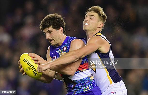 Tom Liberatore of the Bulldogs marks infront of Brad Sheppard of the Eagles during the round 11 AFL match between the Western Bulldogs and the West...