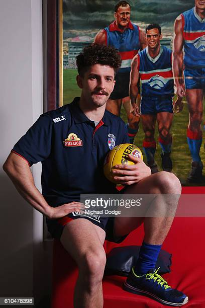Tom Liberatore of the Bulldogs poses in front of a painting of his father Tony Liberatore during a Western Bulldogs AFL media opportunity at Whitten...