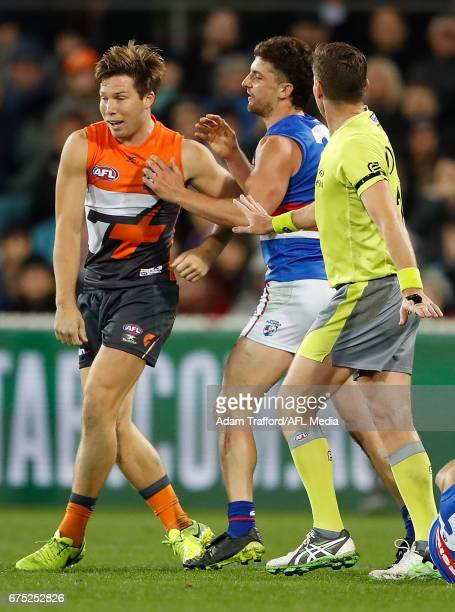 Tom Liberatore of the Bulldogsremonstrates with Toby Greene of the Giants after he laid a late hit on Caleb Daniel of the Bulldogs during the 2017...
