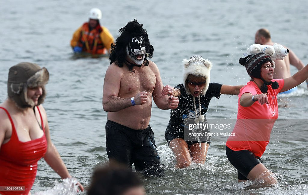 Tom Linhares, in makeup as the Gene Simmons' 'Demon' persona from the band KISS, takes to the waters of Lake Ontario for the 29th anniversary of the Courage Polar Bear Dip for World Vision at Coronation Park in Oakville, January 1, 2014.