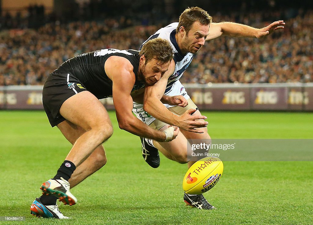 Tom Logan of the Power and Joel Corey of the Cats contest for the ball during the Second Semi Final match between the Geelong Cats and the Port Adelaide Power at Melbourne Cricket Ground on September 13, 2013 in Melbourne, Australia.