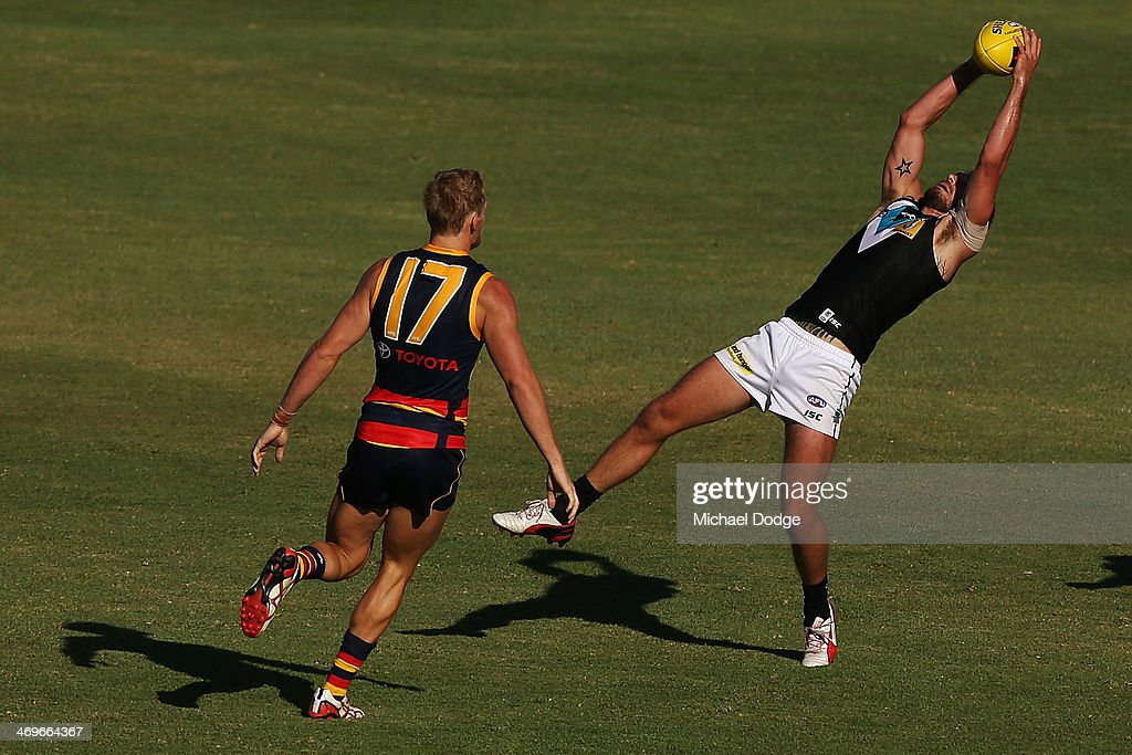 Tom Logan of the Power marks the ball against Sam Kerridge of the Crows during the round two AFL NAB Challenge Cup match between the Adelaide Crows...