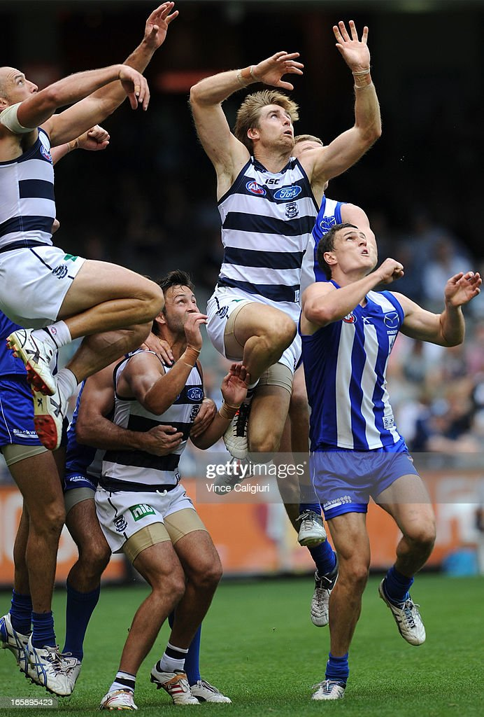 Tom Lonergan (ctr) attempts to mark the ball during the round two AFL match between the Geelong Cats and the North Melbourne Kangaroos at Etihad Stadium on April 7, 2013 in Melbourne, Australia.
