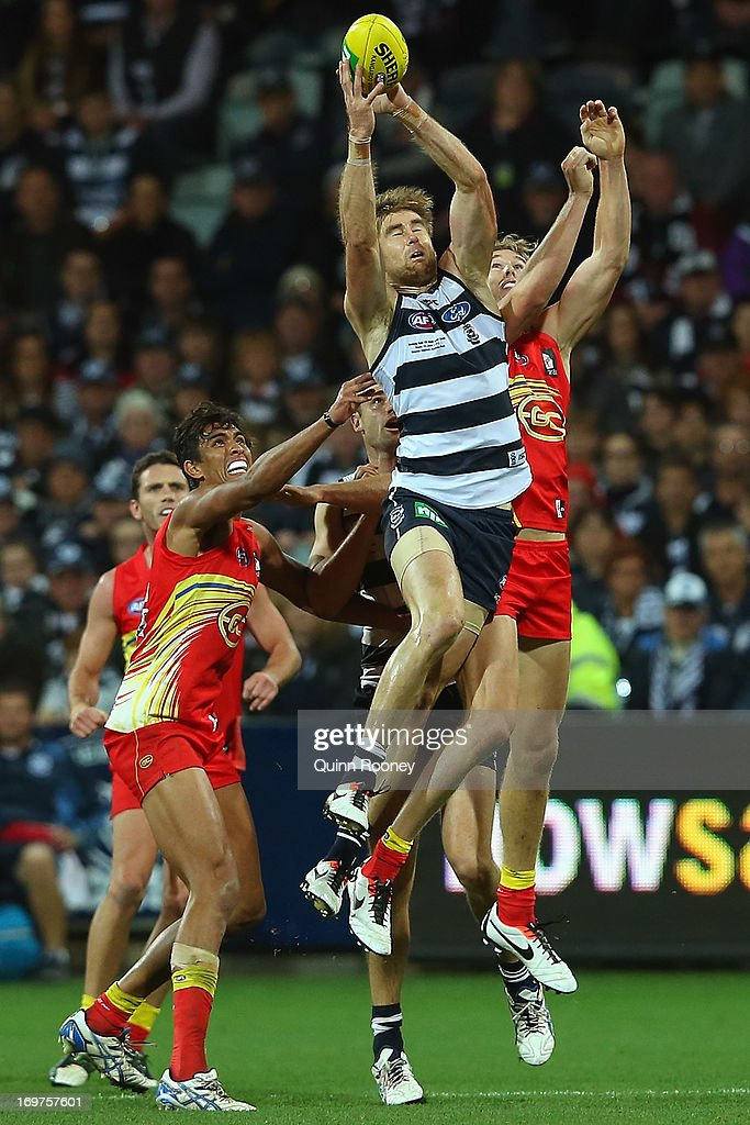 Tom Lonergan of the Cats marks during the round ten AFL match between the Geelong Cats and the Gold Coast Suns at Simonds Stadium on June 1, 2013 in Geelong, Australia.
