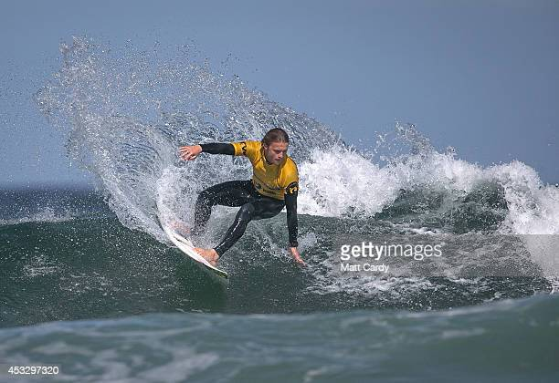 Tom Lowe from St Ives competes in a heat of the UK Pro Surf Association's Men's Open on Fistral Beach on the second day of the Boardmasters surf and...