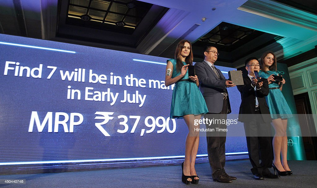 Tom Lu (2 L) CEO, Oppo Mobile India and Steven Shi Feng (2 R ) , General Manager of Oppo Mobile India launching the OPPO Find 7 Smartphone during a press conference on June 11, 2014 in New Delhi, India. The phone will be available in two variants, Find 7 for Rs. 37990 and Find 7A for Rs.31990, and will be available in the market next month.