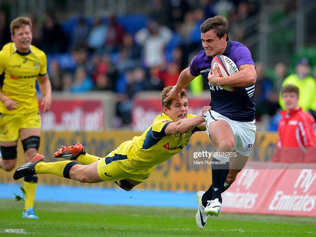 Tom Lucas of Australia can't stop Lee Jones of Scotland scoring a try in a convincing win over Australia during the IRB Glasgow Sevens - Day One at Scotstoun Stadium on May 3, 2014 in Glasgow, Scotland.
