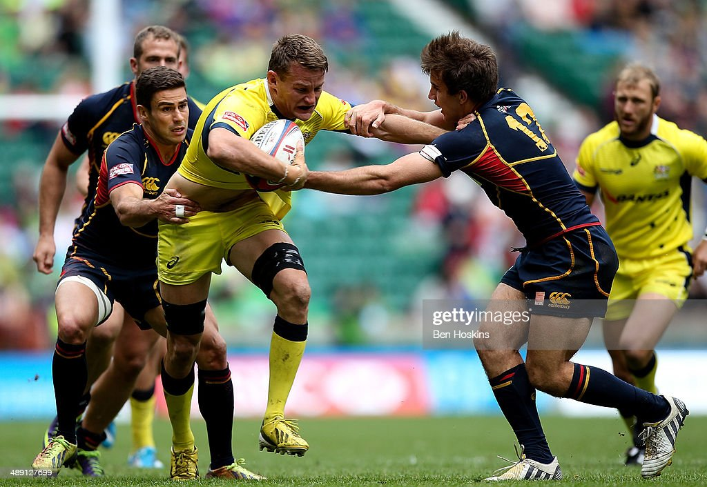 Tom Lucas of Australia is tackled by Pablo Fontes of Spain during the Marriot London Sevens match between Australia and Spain at Twickenham Stadium on May 10, 2014 in London, England.