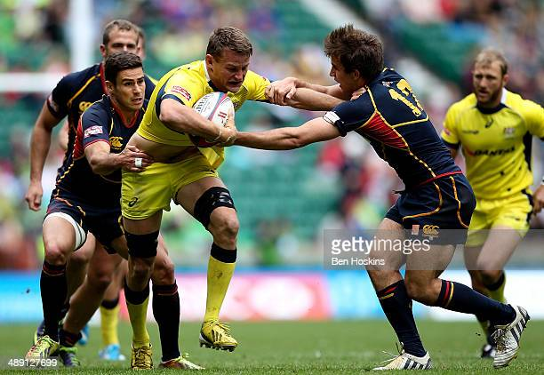 Tom Lucas of Australia is tackled by Pablo Fontes of Spain during the Marriot London Sevens match between Australia and Spain at Twickenham Stadium...
