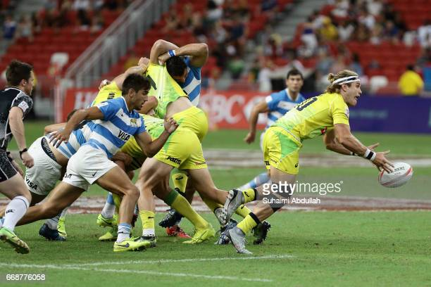 Tom Lucas of Australia makes a pass during the 2017 Singapore Sevens match between Australia and Argentina at National Stadium on April 15 2017 in...