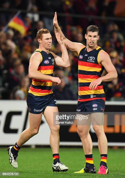 Tom Lynch and Josh Jenkins of the Crows celebrate a goal during the round 12 AFL match between the Adelaide Crows and the St Kilda Saints at Adelaide...