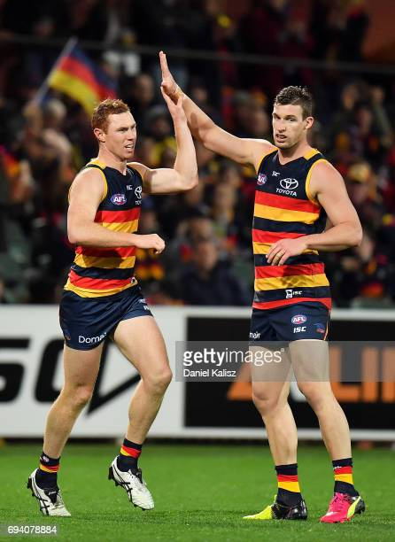 Tom Lynch is congratulated by Josh Jenkins of the Crows after kicking a goal during the round 12 AFL match between the Adelaide Crows and the St...