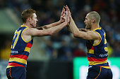 Tom Lynch of the Crows and Scott Thompson of the Crows celebrates a goal during the round 18 AFL match between the Geelong Cats and the Adelaide...