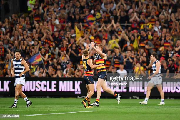 Tom Lynch of the Crows celebrates with David Mackay of the Crows after kicking a goal during the First AFL Preliminary Final match between the...