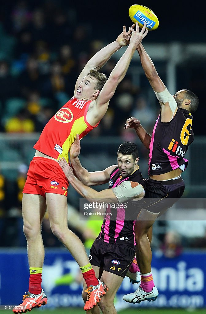 Tom Lynch of the Suns attempts to mark infront of Josh Gibson of the Hawks during the round 14 AFL match between the Hawthorn Hawks and the Gold Coast Suns at Aurora Stadium on June 26, 2016 in Launceston, Australia.