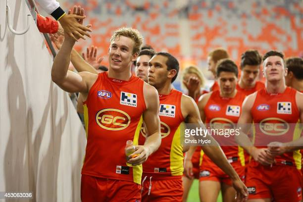 Tom Lynch of the Suns celebrate winning the round 19 AFL match between the Gold Coast Suns and the St Kilda Saints at Metricon Stadium on August 2...