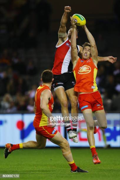 Tom Lynch of the Suns competes for the ball against Nathan Brown of the Saints during the round 14 AFL match between the St Kilda Saints and the Gold...