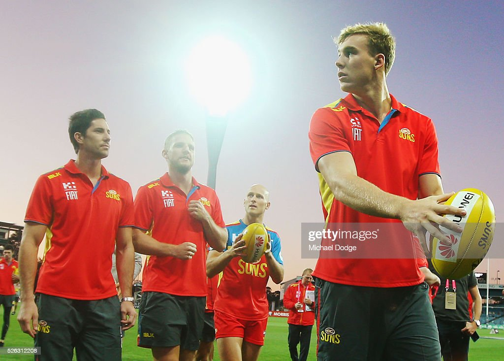 Tom Lynch of the Suns inspects the ground during the round six AFL match between the Geelong Cats and the Gold Coast Suns at Simonds Stadium on April 30, 2016 in Geelong, Australia.