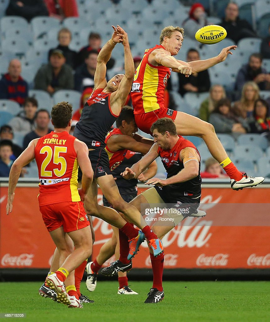 Tom Lynch of the Suns spoils a mark by Daniel Cross of the Demons during the round five AFL match between the Melbourne Demons and the Gold Coast Suns at Melbourne Cricket Ground on April 20, 2014 in Melbourne, Australia.