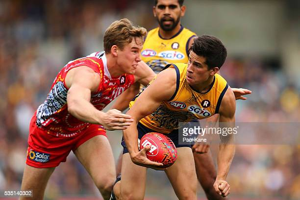 Tom Lynch of the Suns tackles Liam Duggan of the Eagles during the round 10 AFL match between the West Coast Eagles and the Gold Coast Suns at Domain...