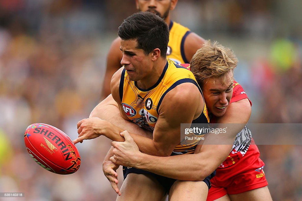 Tom Lynch of the Suns tackles Liam Duggan of the Eagles during the round 10 AFL match between the West Coast Eagles and the Gold Coast Suns at Domain Stadium on May 29, 2016 in Perth, Australia.
