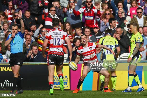 Tom Marshall of Gloucester Rugby celebrates scoring his 2nd try during the Aviva Premiership match between Gloucester Rugby and Sale Sharks at...