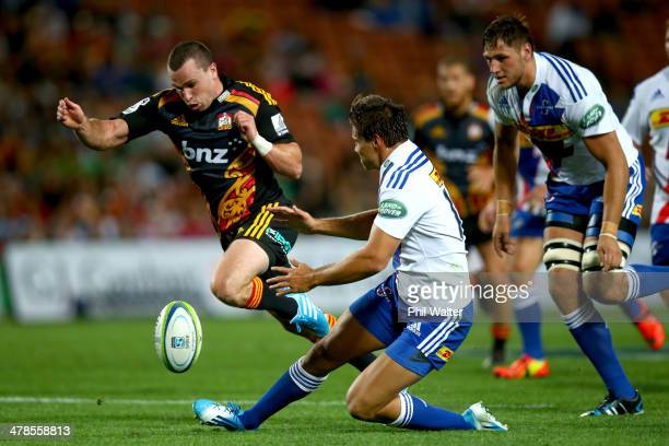 Tom Marshall of the Chiefs kicks forward during the round five Super Rugby match between the Chiefs and the Stormers at Waikato Stadium on March 14...