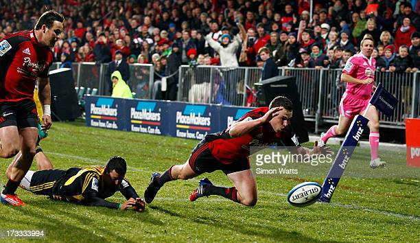 Tom Marshall of The Crusaders beats Alapati Leiua of The Hurricanes to score a try during the round 20 Super Rugby match between the Crusaders and...