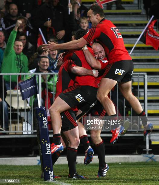 Tom Marshall of the Crusaders celebrates his try with team mate Zac Guildford Willi Heinz and Israel Dagg running in during the round 19 Super Rugby...