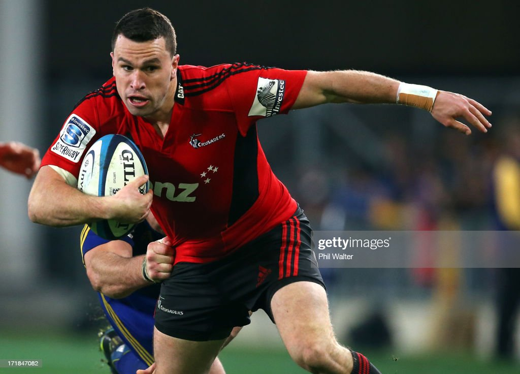 Tom Marshall of the Crusaders runs the ball during the round 18 Super Rugby match between the Highlanders and the Crusaders at Forsyth Barr Stadium on June 29, 2013 in Dunedin, New Zealand.