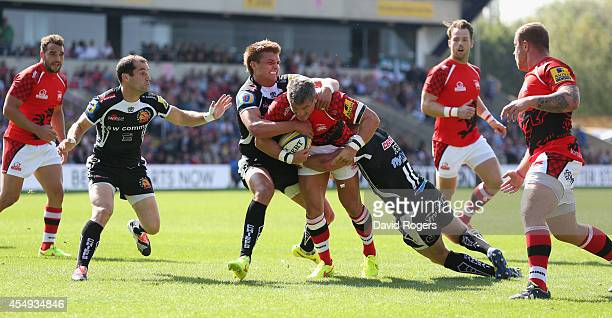 Tom May of London Welsh is tackled during the Aviva Premiership match between London Welsh and Exeter Chiefs at the Kassam Stadium on September 7...