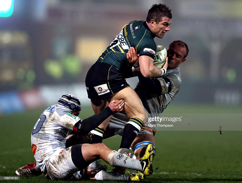 Tom May of Northampton Saints tangles with Jannie Bornman and <a gi-track='captionPersonalityLinkClicked' href=/galleries/search?phrase=Daniel+Kirkpatrick&family=editorial&specificpeople=4236952 ng-click='$event.stopPropagation()'>Daniel Kirkpatrick</a> of Castres Olympique during the Heineken Cup match between Northampton Saints and Castres Olympique at Franklin's Gardens on January 11, 2013 in Northampton, England.