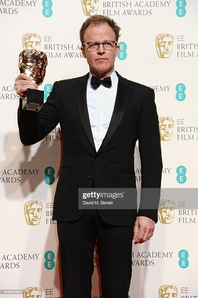 Tom McCarthy, winner of the Original Screenplay award for 'Spotlight', poses in the winners room at the EE British Academy Film Awards at The Royal Opera House on February 14, 2016 in London, England.