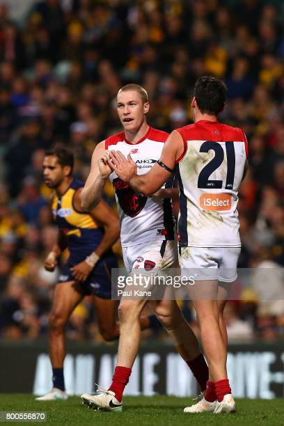 Tom McDonald and Cameron Pedersen of the Demons celebrate a goal during the round 14 AFL match between the West Coast Eagles and the Melbourne Demons...
