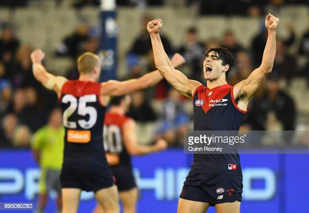 Tom McDonald and Christian Petracca of the Demons celebrate winning the round 12 AFL match between the Melbourne Demons and the Collingwood Magpies...